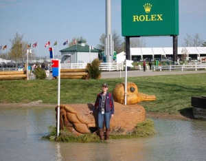Girl standing by Rolex fence